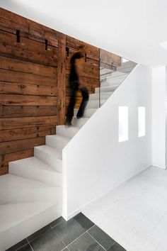 naturehumaine architects - The Naturehumaine Architects know the power of two becoming one. The design studio converted a two-storey duplex into a single unit with a little e...