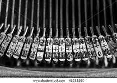strike head consisting of letters and numbers on vintage typewriter