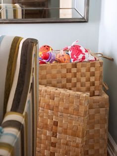 Place furniture in the corners of rooms at an angle and use the space behind to stash baskets of extra linens, toys, crafts supplies, or whatever else you need to store.