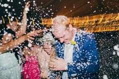 Wedding photography: Bride and groom confetti exit.