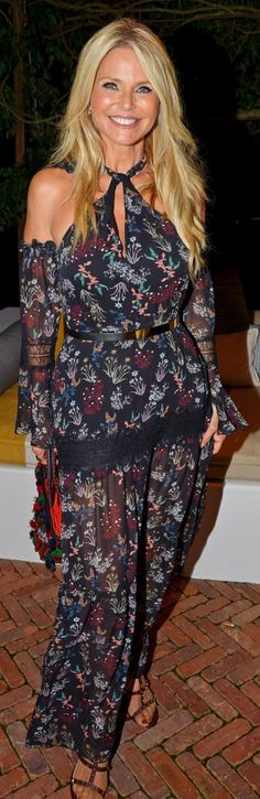 Who made Christie Brinkley's floral cut out dress and studded  sandals? Dress -Nicholas
