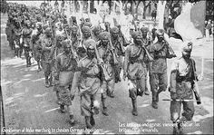"French postcard depicting the arrival of 15th Sikh Regiment in France during World War I. The post card reads, ""Gentlemen of India marching to chasten the German hooligans"""