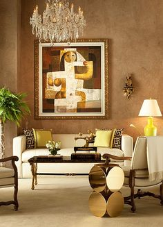 Marvelous mix with a touch of glamor and freshness.  Love the side table.