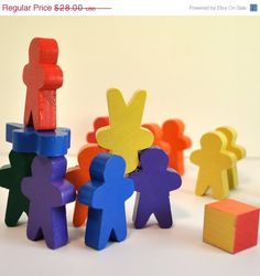 Rainbow Stacking  Men  Game - Educational Toy / Wooden Waldorf  via Etsy.