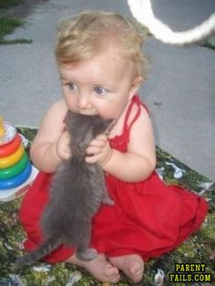 I'm torn between thinking this is such an adorable picture to feeling bad for the poor kitty.