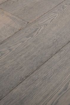 Bleached Grey. Seen better days. Yet all the more charming for it. This is what you get when you let nature takes its course. Chapel Parket wooden flooring.