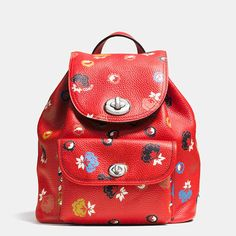 This statement mini rucksack is crafted in plump pebble leather emblazoned with a vibrant, hand-painted print. Adjustable shoulder straps allow for a comfortable carry; brightly polished turnlocks give its perfectly charming design an unmistakable Coach f