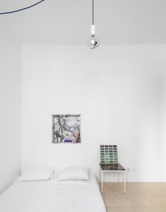 A marble niche and bedside table in a Lisbon apartment designed down to the furnishings by architectural collective Fala Atelier. We featured the project in A Narrow but Glamorous Marble-Clad Apartment. Photography byFernando Guerra, courtesy of Fala Atelier.