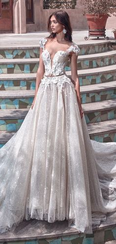 Galia Lahav 2018 fairytale ball gown - A fairytale ball gown made of real silver twilight sparkly net with an embellished corset, embroidered with 3D silk flowers with crystal accents and a plunging V sheer feature. A neo Victorian bustle petticoat made of sheer nude organza and silk ribbons. The Petticoat is made of wide panels which form a voluminous and dramatic volume.