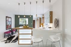 """Beautiful """"Makaja Bella"""" at Eden Rock Forest Estate: Beautiful open kitchen space with some hanging lamps and a white counter.  Click to find more inspiration!"""