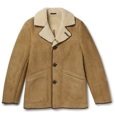 TOM FORD Leather-Trimmed Shearling Coat — $6,950.00. A luxurious take on '70s vintage styles, this tan design is trimmed with sleek brown leather. Made in Italy from plush shearling, TOM FORD's coat displays his inimitably sophisticated aesthetic. Wear it over a turtleneck sweater and jeans.