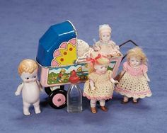 Four German pink-tinted all-bisque dolls by Hertwig.... I like the Pram