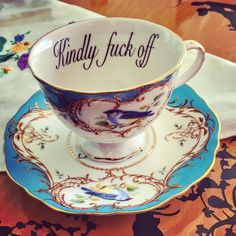 """Social norms might restrict you from revealing to people how you feel about them, but that doesn't mean you can't get around it. Miss Havisham has created a delicate series of not-so-subtly insulting cups """"for the lady who speaks her mind"""". My Cup Of Tea, Tea Cup Saucer, Belle Photo, Geeks, Afternoon Tea, Kitsch, Tea Time, Decoration, Tea Party"""