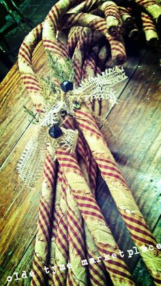 Candy canes - we have homemade ones on our tree that we made more than 15 years ago. So simple, but they are very cute.