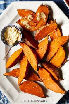 There's no way to rush when making this easy, healthy side dish—medium sweet potatoes are wrapped in parchment and foil and roasted for an hour and a half until they're super tender with a sweet flavor. #marthastewart #recipes #recipeideas #christmasrecipes #christmaspotluck #christmasfood