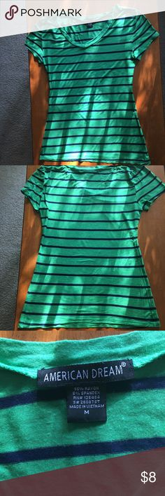 Green and black horizontal striped tee T - shirt 🔴CAN BE BUNDLED FOR $3🔴. Very soft.Only worn about 2-3 times. Very Stretchy👌 ARMPIT TO ARMPIT MEASURES ABOUT 16 INCHES.  Height (starting from where the tag is) to the bottom is about 24 inches. It is a little see-through, though the colors are very vivid. This shirt is too tight on me for my taste but it may look good on somebody else!👍 Ask me any questions! American Dream Tops Tees - Short Sleeve