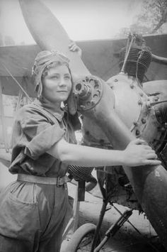 Female pilot with her aircraft (Soviet Union - 1930s)