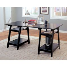 This trestle style office desk in a black finish features a large working area and four open storage shelves below. Keep all your supplies and papers handy with plenty of storage space.