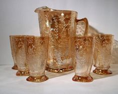 Beautiful Jeannette Glass Floragold Iridized Carnival aka Louisa Pitcher and 6 Tumbler Set by OldTownFinds on Etsy American Press, Pickle Jars, Glass Pitchers, Fenton Glass, Indiana Glass, Vintage Dishes, Displaying Collections, Pressed Glass, Carnival Glass