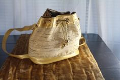 Vintage 1980s Timothy Hitsman Gold Bucket Bag -- Handbags - Inspirations by Rebecca -- vintage Timothy Hitsman bag -- www.inspirationsbyrebecca.com