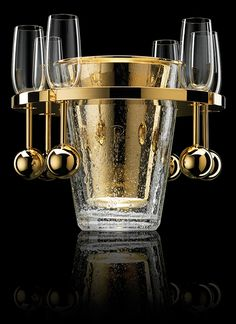 Gold luxury ice bucket with champagne flutes with a ball