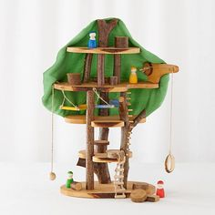 This doll-size tree house features a clever design with tons of playful built-in accessories like a rope ladder, a wooden tetherball, and even some hammocks. | The Land of Nod