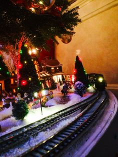 Trains around the Christmas tree at our home in Ohio, love setting up the Village (nostalgic)