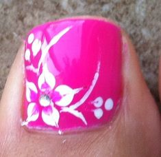 hot pink hawaiian flower nail art with tree dots on the side of the flower .