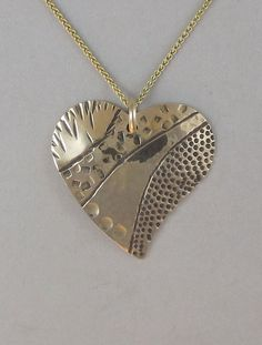 14K Stamped Heart Pendant  $630.00