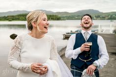 Bride with a glass of wine and groom with a pint of Guinness on the shore of Lough Eske with Harvey's Point in the background as the sun was setting. Photo by Paul McGinty from Ghorm Studio Photography, www.ghormstudio.ie