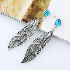 es.aliexpress.com store product Vintage-Leaf-Earrings-Simple-Alloy-Hollow-Women-Long-Dangle-Earrings-Ethnic-Carving-Turquoise-Dangle-Elegant-Jewelry 2389094_32780133467.html?spm=2114.04020208.3.86.XNaO2g&s=p&ws_ab_test=searchweb0_0%2Csearchweb201602_6_10000073_10065_10068_10501_10000074_10000132_10000033_10503_10000030_119_10000167_10000026_10000175_10000126_10000023_10000129_10000123_432_10000069_10000068_10060_10062_10056_10055_10000062_10054_10000063_10059_10000120_1...