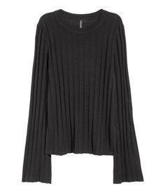 Black. Rib-knit sweater in a soft viscose blend with long, flared sleeves and overlocked edges at cuffs and hem.