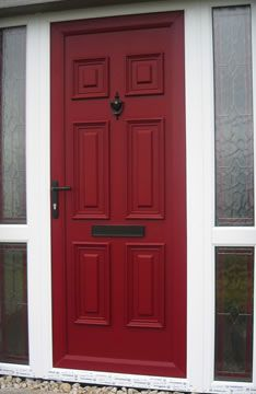 Red Front Door With Pale Yellow House