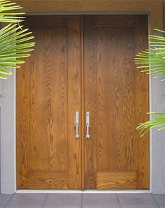 """DbyD-5003.  This Contemporary Front Entryway is installed on a modern home in Ponte Vedre Beach, Florida.  The pair of 36"""" X 96"""" Modern Exterior Doors consist of one Solid Oak Flat Panel and were furnished Pre-Hung in an oak jamb.  The Hardware is Baldwin 6562 Mortise Hardware."""
