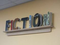 DIY library signage with weeded books.