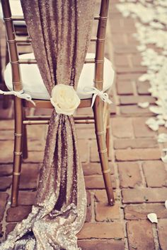 Sequin chair decor for the #ceremony Photography: Tamiz Photography - www.tamizphotography.com Read More: http://www.stylemepretty.com/2014/08/27/glamorous-maui-destination-wedding/