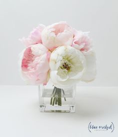 This silk peony arrangement is full of beautiful, silk flowers. The pink peonies are mixed with white peonies to create a very lush and soft arrangement. The flowers are set in a beautiful, glass vase with faux water. Brighten your space with some fun, home decor; or, use this as a centerpiece! The arrangement comes in a square, glass vase with faux (acrylic) water. This arrangement is about 10 tall and 10 wide at its fullest area. Gift Options: Sending this as a gift to a friend or loved…