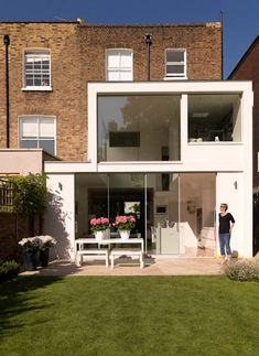 """Boscombe Road.          This project involved the refurbishment and extension of a Victorian house - creating a large double height Kitchen/Living space to the rear of the house with large areas of glazing opening to the garden, providing light deep inside the building and views outwards. The interior was opened up to create larger, more useful spaces. The external form of the extension is designed to make the building feel as """"weightless"""" as possible visually, in counterpoint to the masonry…"""