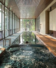 A 75-foot-long, single-lane lap pool is naturally lit by the floor to ceiling windows during the day. Indoor Pools, Lap Pools, Backyard Pools, Backyard Landscaping, Backyard Ideas, Langer Pool, Design Hotel, House Design, Design Interiors
