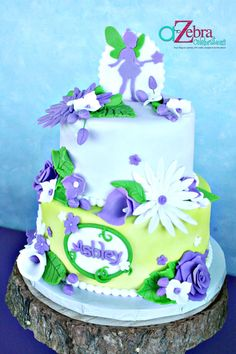 Cake idea but without the fairy on top and the flowers yellow and  white and each layer with white fondant