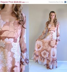 DIVINE 70s dress! Stunning boho dress features an oversized floral print in cocoa brown, nude, white and peach. Empire waist, scoop neckline, and