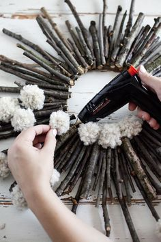 Make a twig and pom pom starburst wreath— It's practically free! ideen Twig & Pom Pom Starburst Wreath - A Beautiful Mess Twig Crafts, Pom Pom Crafts, Nature Crafts, Diy And Crafts, Decor Crafts, Moon Crafts, Pine Cone Crafts, Creative Crafts, Holiday Crafts