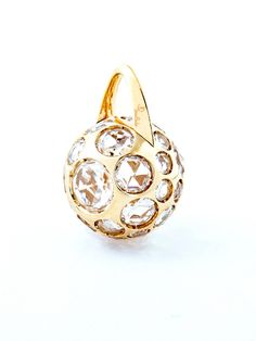 Pomellato 18k Yellow Gold Harem Ball Rock Crystal Pendant. 18k Yellow Gold Ball with Rock Crystals. Available at London Jewelers.