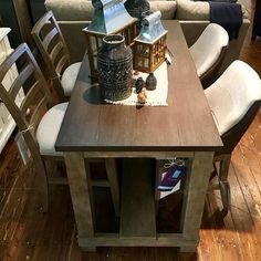 Check out the height on this stunning dining table with ladder back stools and upholster host stools. Love it!