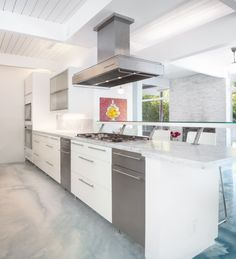 The modern kitchen has a breakfast bar.