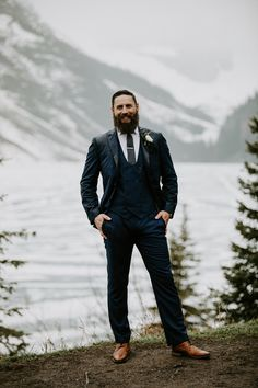 Stylish navy blue suit for grooms. To see more of this mountain wedding in Lake Louise visit Teller of Tales Photography. Wedding Songs, Wedding Couples, Wedding Photos, Wedding Ideas, Pink Wedding Theme, Navy Blue Suit, Groom Attire, Bride Gifts, Grooms
