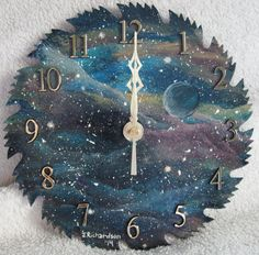 Hey, I found this really awesome Etsy listing at https://www.etsy.com/listing/213518953/hand-painted-saw-blade-clock-space-time