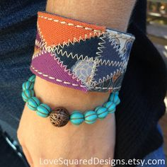 Patchwork colorful cuff bracelet by LoveSquaredDesigns on Etsy Purchase individually or together: • Unique fabric colorful patchwork cuff (a LUCKY brand belt in it's former life) • beaded aqua bracelet with copper focal bead (Save $5 when you order both!)