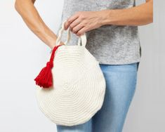 Round Crochet Bag with Tassel. We wanted to design something you could take along with you to lunch with your girlfriends Crochet Baby Dress Pattern, Crochet Edging Patterns, Crochet Basket Pattern, Pillow Patterns, Hat Crochet, Crochet Triangle Scarf, Easy Crochet Stitches, Tassel, Girlfriends