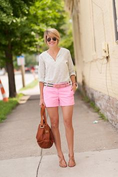 Cute pink shorts and ivory tunic with neutral sandals